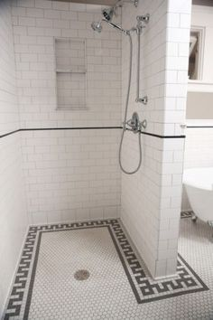 White and grey Greek key pattern - tile flooring boardering the walls helping to define the space