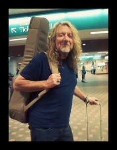 Robert Plant, with guitar, will travel....