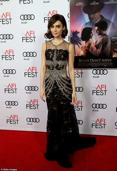 Stunning: Lily Collins didn't disappoint as she dazzled in an impressive fish tail sheer paneled gown on the red carpet at the premiere of her latest movie