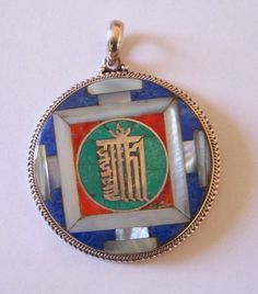 Good luck Mandala Pendant in Lapislazuli, Coral, Mother of Pearl and Malachite. In the middle is Kalachkraone one of the highest mantra.  Helps to eliminate negative energy and to attract fortune