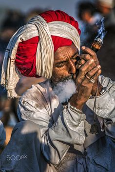 Smoking my worries away - A camel seller relaxing witha  smoke after a tough day at work, Pushkar , India