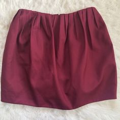 Kate Spade Saturday pleated tulip burgundy skirt Side pockets. Zipper in back kate spade Skirts