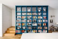 A blue book case adds a bit of color to the bright interior. Buyers of the Tilley row houses were able to customize the interior finishes including native Texas pecan flooring.