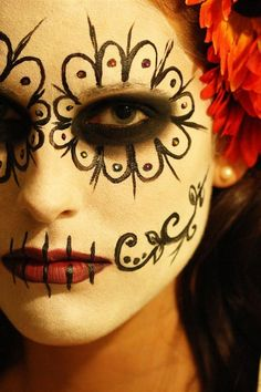 "La Calaveras Catrina (The Elegant Skull) - Aside from the color palette, I like the red lips, smaller ""eye sockets,"" and relative simplicity of the design."