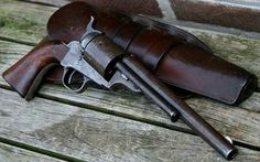 Colt .44 Single Action Revolver with conversion mods.