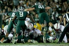 Kyler Elsworth dives into the pile to help stop the Stanford Cardinal on fourth down to take possession in the final moments of their 24-20 win in 100th Rose Bowl Game presented by Vizio at the Rose Bowl on January 1, 2014 in Pasadena, California. (Photo by Stephen Dunn/Getty Images)