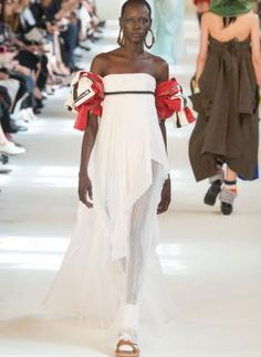 Experiments of opposing styles , layering games, bright colors, variable lengths from mini to absolute maxi: the new haute couture fall/winter 2016-17 collection by Maison Margiela is desecrating, eclectic, hyperbolic, pyrotechnic in its bold will to escape from any kind or any try of definition. - See more at: http://catwalkmaisonmargiela.ufashon.com/collection/fw-2016-17