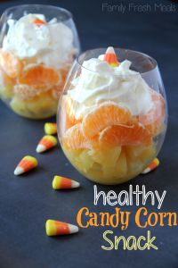 Healthy Halloween Snack Candy Corn Dessert!  What a cute idea to layer pineapple, orange segments (or mandarin oranges) and top with whipped cream!  Garnish with a couple pieces of the real deal!  :)