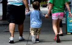 Jonah Garvey, 2, walks with his grandmother, Lynn Taverneses, left, and cousin, Frances Toomey, in Syracuse, N.Y.