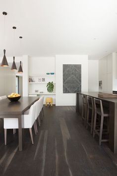 Dark floors, white clean kitchen by Canni | on Desire to Inspire