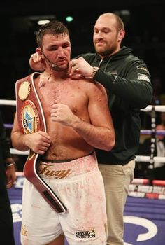 Hughie Fury celebrates victory over Fred Kassi with Tyson Fury