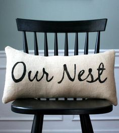 Our Nest Pillow Cover by CariJoy Designs.  Up the coziness factor of your abode by tenfold with this sweet burlap pillow cover. It's made from high-quality burlap fabric, which has been stenciled with black textile paint — simply slip it over a pillow, and enjoy. Welcome home.   $23.00 (5 left as of 6/30/14)  @scoutmob