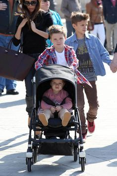 Cruz Beckham pushed his little sister Harper in her stroller during a visit to the Louvre. Click for more pictures!
