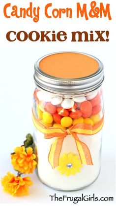 Candy Corn M&M Cookie Mix in a Jar Recipe! ~ from TheFrugalGirls.com ~ such a fun, easy mason jar gift to give this Fall to friends, family, neighbors, co-workers and teachers... it makes the BEST cookies!! #masonjar #recipes #thefrugalgirls