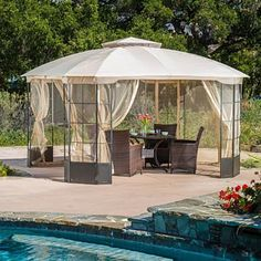 The Sonoma Gazebo adds a functional touch to any outdoor living space. The polyester covering offers the perfect shade solution while maintaining a clean feel. The steel frame of the gazebo is durable and comes with adjustable netting to enclose the gazebo for added shade or nighttime protection from the elements. This is the perfect piece for anything from relaxing in solace to entertaining guests.FeaturesConstructed with a steel frame and polyester fabricColor options include light brown…