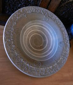 Spiral slip bowl; high hills clay, slip trailed designs, deweese white slip inside and soda fired. pottery ceramics