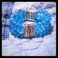 Beautiful Blue Beaded Crystal Bracelet !!MUST GO!! Handmade bracelet the beads have 3 holes then I used 8 mm crystal sky blue beads in the middle of the spacer beads. Any questions let me know creationcentral Jewelry Bracelets