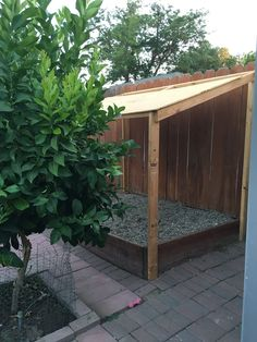 Covered outside dog potty area.  My hubby built this 8 years ago. A little wood, some rocks and training the fur children.  Keeps their paws cool during the summer and dry during the winter. #DogRun