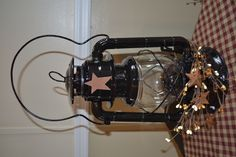 I like decorating with authentic antique lanterns..this one was spray painted added a rusty star with a pip spray and you can add a battery tea light candle inside preferably a timer one..So cute on a shelf or hanging..