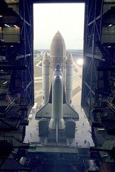 """ The first Space Shuttle vehicle destined to fly in space inches out of the Vehicle Asembly Building on its way to Pad A at Complex 39, where it will be launched. The STS-1 vehicle..."