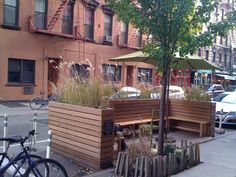 reason for providing seating in the public realm is to promote a lively, sticky sidewalk and is often associated with commercial uses.  The Sullivan Street seat, shown above, was installed under the NYC Street Seats program while the ASLA-award winning Powell Street Promenade in San Francisco is part of that city's Parklets program.