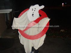 Homemade Ghost Buster Costume: This Homemade Ghost Buster Costume was my daughter Christy's idea. We used a large cardboard box and painted it red. Used another piece of the box to cut