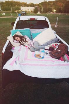 Fill a truck bed with blankets and pillows and go stargazing