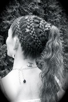 Renaissance Braid Hairstyles for Peasants | Heirloom Hair Braiding With leafy vines laced into the braid on the bottom half and turning into flowers in the top Hal with draping rope braids with flowers and vines woven in them through out hair