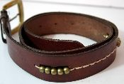 """Vintage latigo and brass leather belt made in India. Heavy brass buckle and beads. Measures 31""""."""