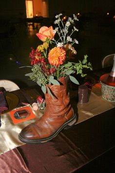 Groom's boot used as centerpieces.