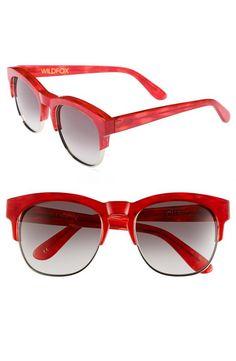 Red sunglasses are pretty :)