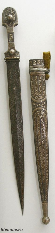 "Circassian (Adighe) dagger of the ""Kabardian"" type. XIX century. Steel, wood, leather, silver, notch. The total length is 43.5 cm / Черкесский (адыгский) кинжал ""кабардинского"" типа. XIX век. Сталь, дерево, кожа, серебро, насечка. Общая длина 43,5 см."