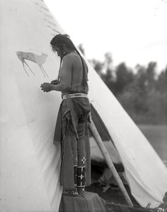 Painting the tipi. Early 1900s.Blackfoot man. Photo by Richard Throssel. Source - University of Wyoming, American
