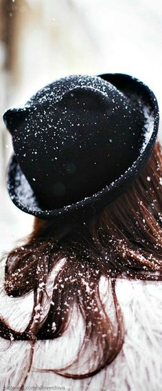 // Cat ears  Bowler Hat and White Faux Fur Coat. The best thing though is the falling snow.