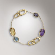 """<Marco Bicego - (Murano) BB1668 MIX300 - 18k yellow gold bracelet, hand engraved with the time-honored Bulino technique.  This jewel mounts cushion cut, irregular and faceted Yellow Quartz, London Topaz, African Amethyst and Iolite stones. This collection is charcterized by polished gold elements.  Length:20 cm 