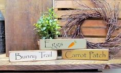 "This set of 3 Easter / Spring stackable signs measure 9"" Long by 2"" High. They look great on a shelf, window sill, atop of a door or just randomly scattered. One is painted sage green, one mustard yel"