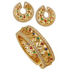 Cartier Ruby Emerald Diamond Gold Bangle and Earrings | From a unique collection of vintage bangles at https://www.1stdibs.com/jewelry/bracelets/bangles/