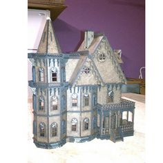 The Leon Gothic Victorian Mansion 1:48 scale dollhouse measures 12.5 W x 5.5D x 13 H (inches). It has detailed porch framing, Victorian gingerbread corbels, Victorian gingerbread gable ornaments, railings, window frames, Plexiglas window inserts, detailed sub frame, and more.
