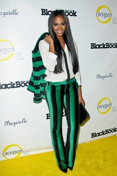 Tika Sumpter Pantsuit - Tika Sumpter attended Fashion's Night Out wearing a boldly striped green and black pantsuit.