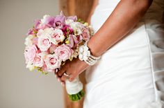 Gorgeous! Pink roses, freesia, orchids and a little glam on the handle
