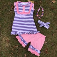 Our super cute purple and pink striped short outfit has adorable buttons and ruffles. Perfect for any girly girl! This girl's boutique outfit is high quality and so trendy. A beautiful addition to her