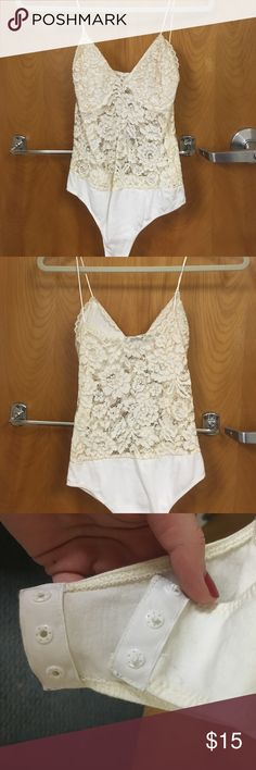 Zara lace bodysuit Cream Zara lace body suit. Never worn. Button closure at bottom. I am an XS/s and this fits perfectly. Please ask any questions! (This isn't lingerie- it's a bodysuit, the boon portion is not see through but the stomach is slightly) Zara Tops