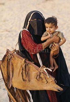 Bedouin woman with child, Qatar. Photograph by Eye Ubiquitous