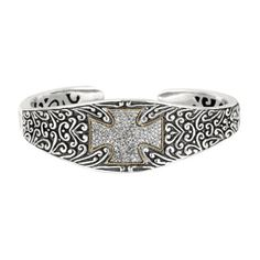 """18K/SS 7.5\"""" CUFF BANGLE     Diamond Byzantine Cross Cuff. From the Byzantine Filigree Collection, this cuff is crafted in oxidized sterling silver and solid 18kt gold, and is set with .75 carats of white diamonds. Inspired by the designers first trip to modern day Istanbul as a student where he experienced the rich history of Constantinople, the eastern capital of the Roman empire otherwise known as the Byzantine Empire. This cuff also features a hinged mechanism which allows for easier…"""