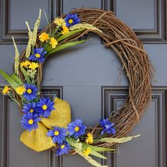 Natural looking Summer grapevine wreath with yellow and blue accents and yellow burlap ribbon; Monogram; Mother's Day gift by SimpleWreath on Etsy