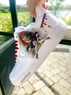 Chucky custom Air Force from Saint Desingz. These shoes have 1 Chucky portrait on each shoe, red shoe laces, and blood drips on the swoosh. ALL HAND PAINTED.
