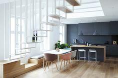 Oslo duplex by Haptic architects _ cuisine monochrome et banc le long de la fenêtre