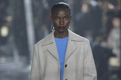 Nothing announces the Eighties like a bold shoulder on a sharply tailored coat.