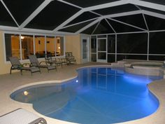 pool area at night with color changing LED-light, waterfall, whirlpool,