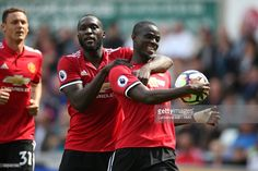 Eric Bailly of Manchester United celebrates after he scores a goal to make it 0-1 with Romelu Lukaku of Manchester United during the Premier League match between Swansea City and Manchester United at Liberty Stadium on August 19, 2017 in Swansea, Wales.